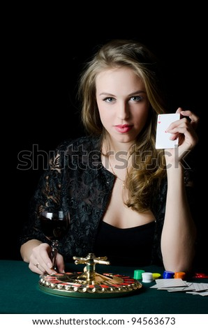 The beautiful girl with a playing card - stock photo
