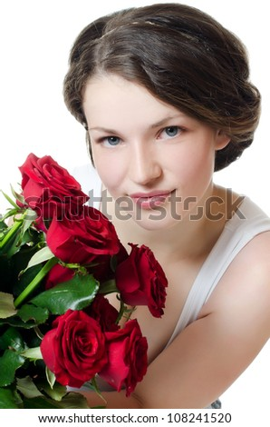The beautiful girl with bouquet of roses - stock photo