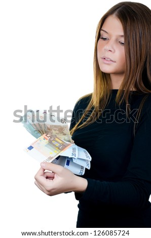 The beautiful girl with euro banknotes isolated