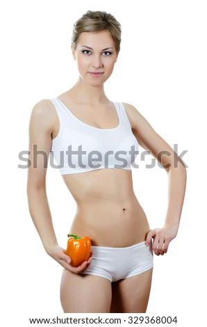 The beautiful girl with fresh pepper  isolated