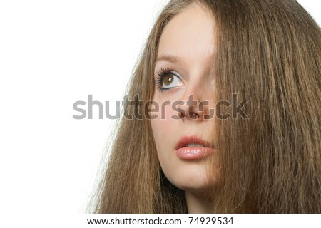 The beautiful girl with long healthy hair. It is isolated on a white background