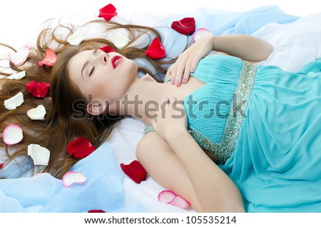 The beautiful girl with petals of roses - stock photo