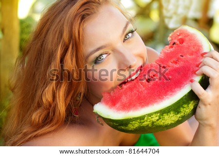 The beautiful  girl with water-melons