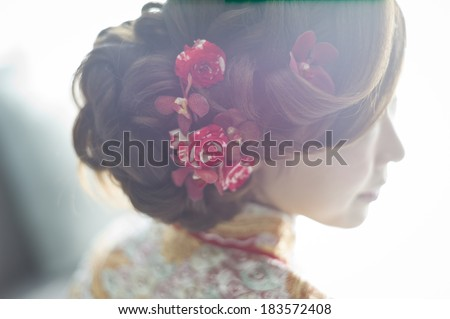 The beautiful hairstyling for Chinese bride - stock photo