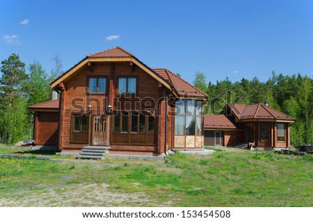 The beautiful house on a forest glade in the summer  day