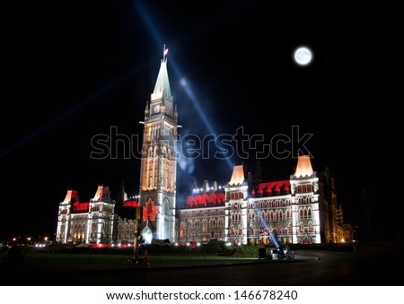 The beautiful illumination of the Canadian House of Parliament at night - stock photo