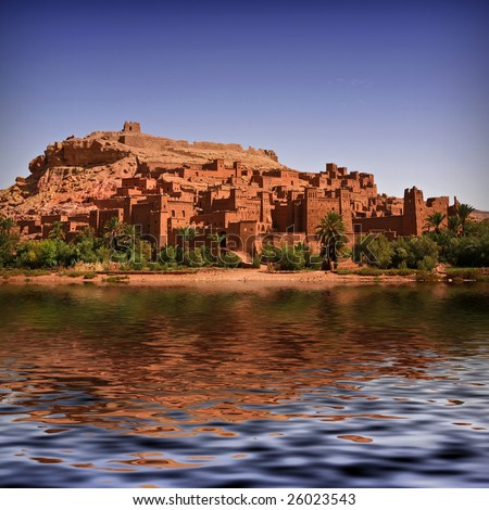 The beautiful Kasbah of Ait Benhaddou with the river full of water. Morocco background - stock photo