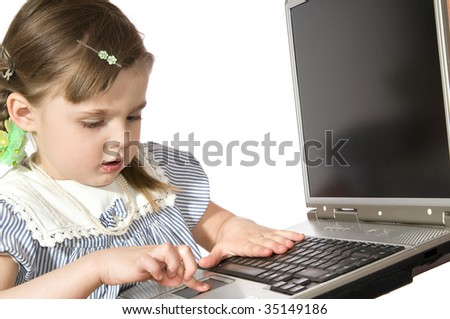 The beautiful little girl Plays on computer  on white background close up