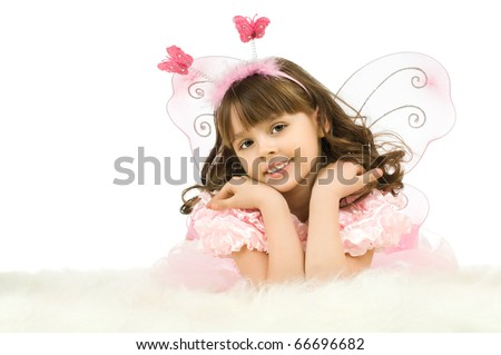 the beautiful  little girl with wings, lie and  smile on white background, isolated - stock photo