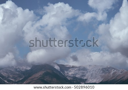 The beautiful mountain on the background of cloud stream. Wide angle