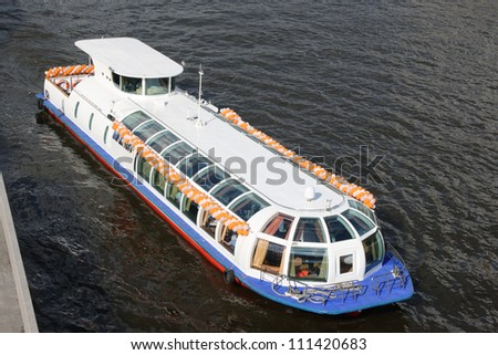 The beautiful passenger steam-ship floats on the river