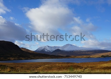 The beautiful place with mountain and  lake is located in Scotland. We drove a long way for taking a very nice photo there.