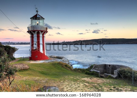 The beautiful red and white Hornby Lighthouse on South Head, Sydney Australia, the entrance to Sydney Harbour, at dawn. - stock photo