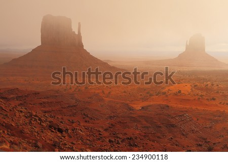 The Beautiful Red Navajo Sandstone of the Iconic Landscape of Monument Valley - stock photo