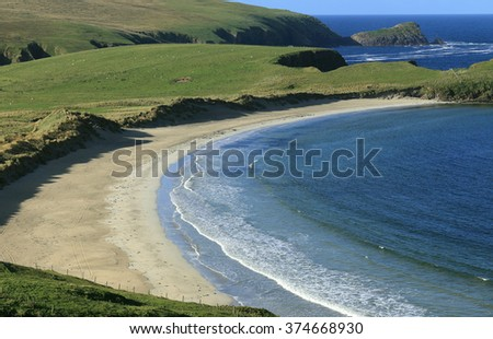 The beautiful sandy beach in the Bay of Scousburgh, south Mainland, Shetland, Scotland, UK. - stock photo
