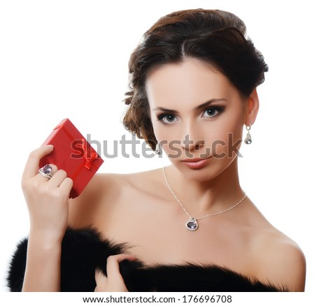The beautiful sensual  woman with expensive jewelry - stock photo