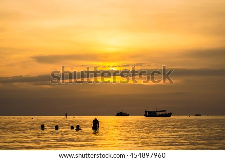 The beautiful silhouette evening sunset with people on beach at the sea, Koh tao, Thailand