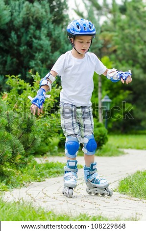 The beautiful skater boy in park - stock photo