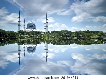 The Beautiful Sultan Salahuddin Abdul Aziz Shah Mosque (also known as the Blue Mosque) Image has grain or blurry or noise and soft focus when view at full resolution. (Shallow DOF, slight motion blur) - stock photo
