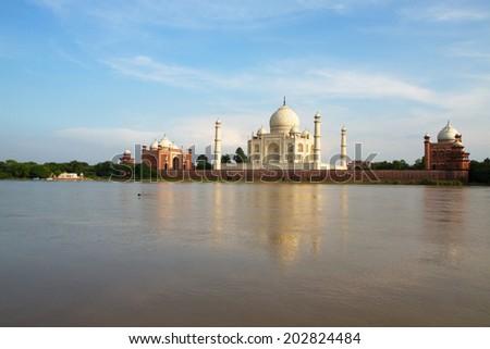 The beautiful Taj Mahal (Uttar Pradesh, India), seen from across the river.  The greatest monument to love! - stock photo