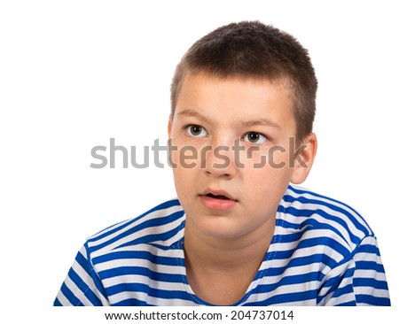the beautiful thoughtful boy the teenager isolated on a white background - stock photo