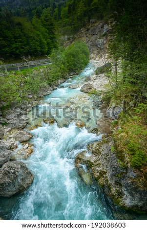 The beautiful turquoise Soca river in the Triglav National Park in Slovenia.