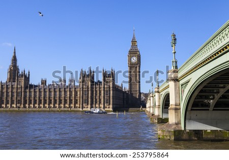 The beautiful view across the river Thames of the Houses of Parliament and Westminster Bridge in London. - stock photo