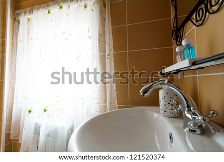 The beautiful water faucet in a bathroom - stock photo