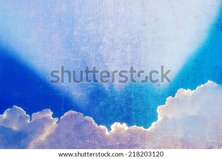 The beautiful white and yellow clouds and blue sky vintage background. - stock photo
