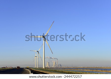 The beautiful windmill under the blue sky