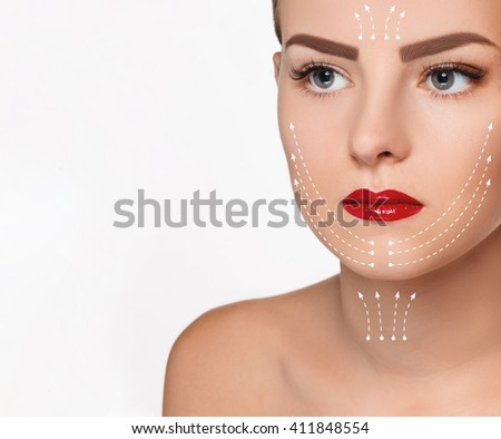 The beautiful woman face  with arrows close up over white background - stock photo