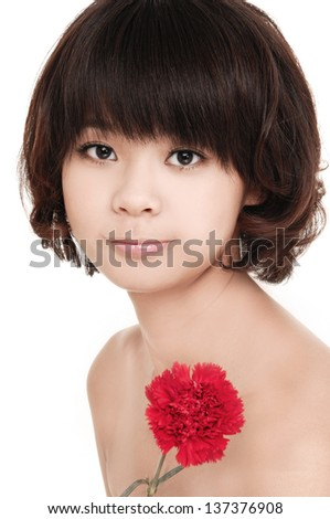 The beautiful woman holds a flower of a carnation - stock photo