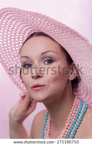 The beautiful woman in a pink hat  - stock photo