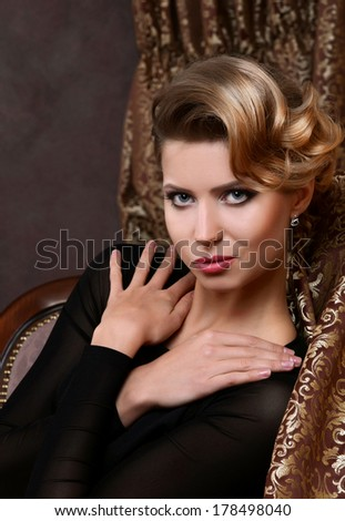 The beautiful woman in a retro style - stock photo