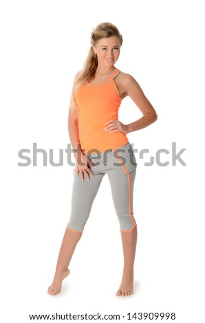 The beautiful woman in a sports suit - stock photo