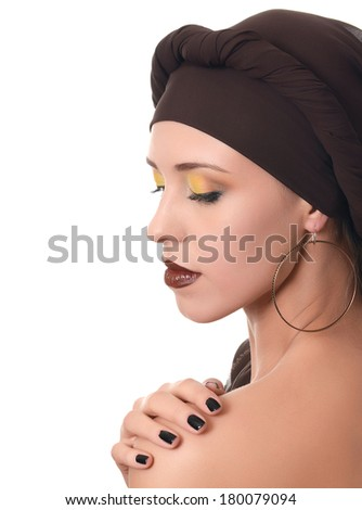The beautiful woman in a turban with a creative make-up - stock photo