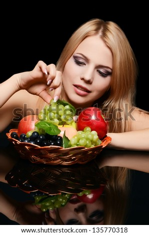 The beautiful woman with a basket of fruit - stock photo