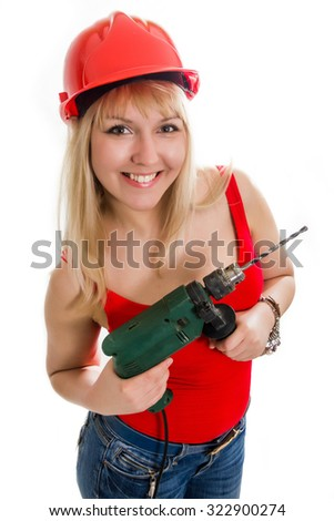 The beautiful woman with a drill in hands, isolation on the white - stock photo