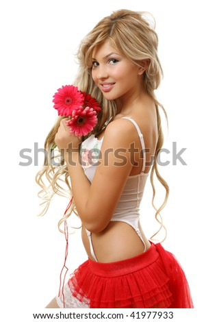 The beautiful woman with a flower - stock photo