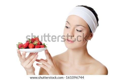 The beautiful woman with a strawberry isolated