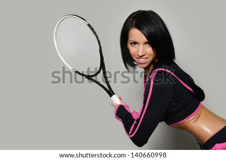 The beautiful woman with a tennis racket
