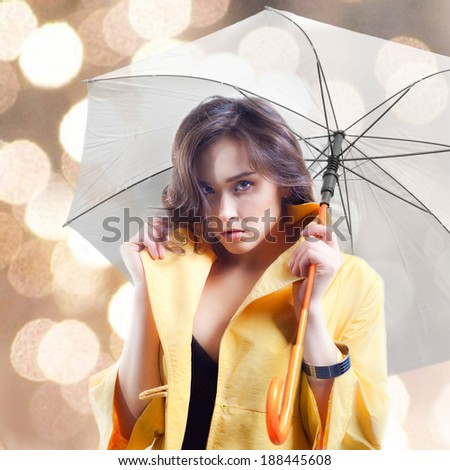 The beautiful woman with an umbrella.