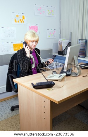 The beautiful young business woman at office
