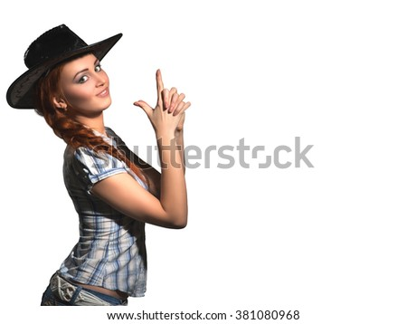 The beautiful young girl in a cowboy's hat, shows the gun fingers of hands of on an isolated white background with clipping pathwhite background with clipping path - stock photo