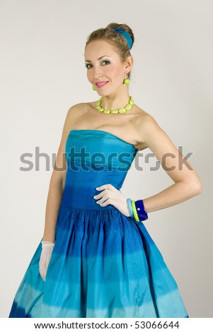 The beautiful young lady in a blue dress in retro style