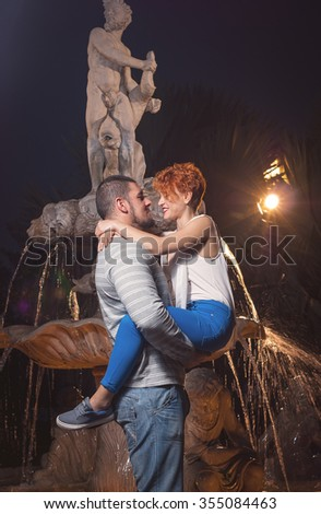 the beautiful young loving couple was photographed in park on walk