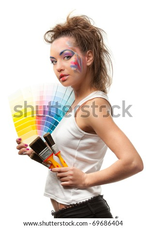 The beautiful young woman with a color guide and paintbrushes on a white background. Designer of interior. - stock photo