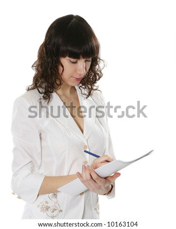 The beautiful young woman writes in documents