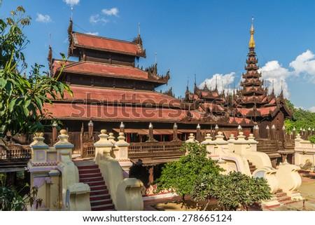 The beautifully carved teak monastery Shwe In Bin Kyaung  in Mandalay - stock photo