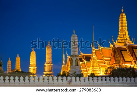 The beauty of the Emerald Buddha Temple at night. And while the gold of the temple catching the light. This is an important buddhist temple of thailand and a famous tourist destination. - stock photo
